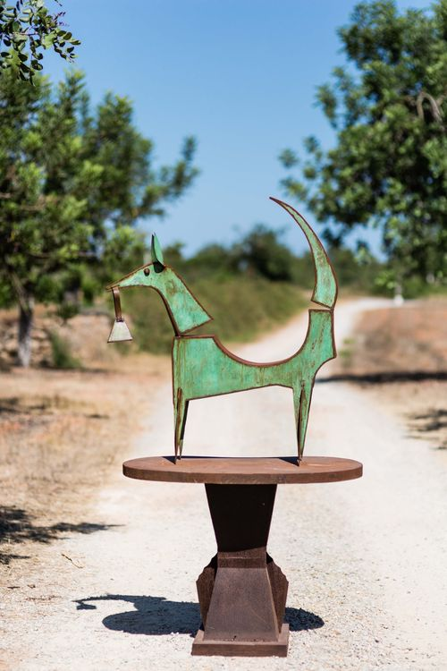 Green dog by Christopher Stone - search and link Sculpture with SculptSite.com