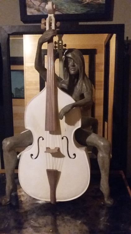 woman with cello by Edward Kitt - search and link Sculpture with SculptSite.com