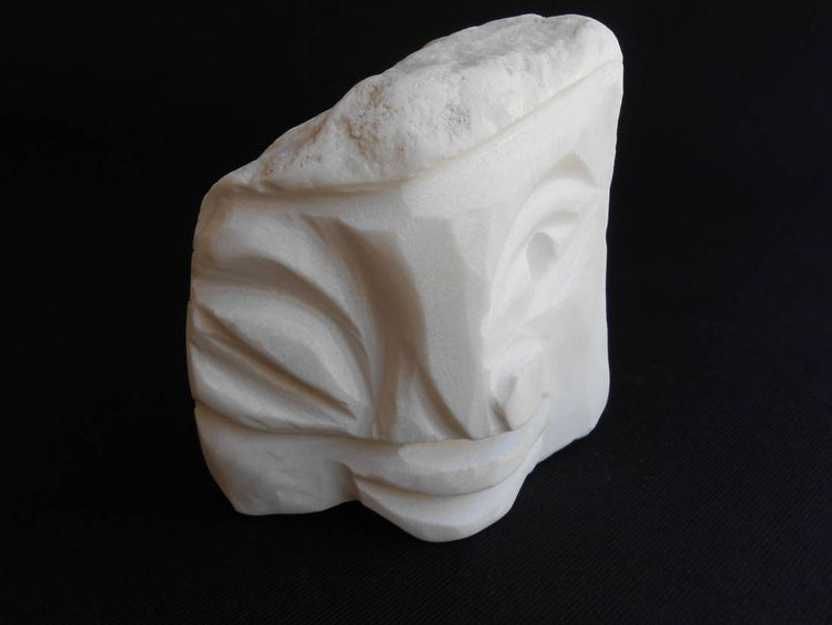 IN THE PALM OF YOUR HAND Winking White by David Willis - search and link Sculpture with SculptSite.com